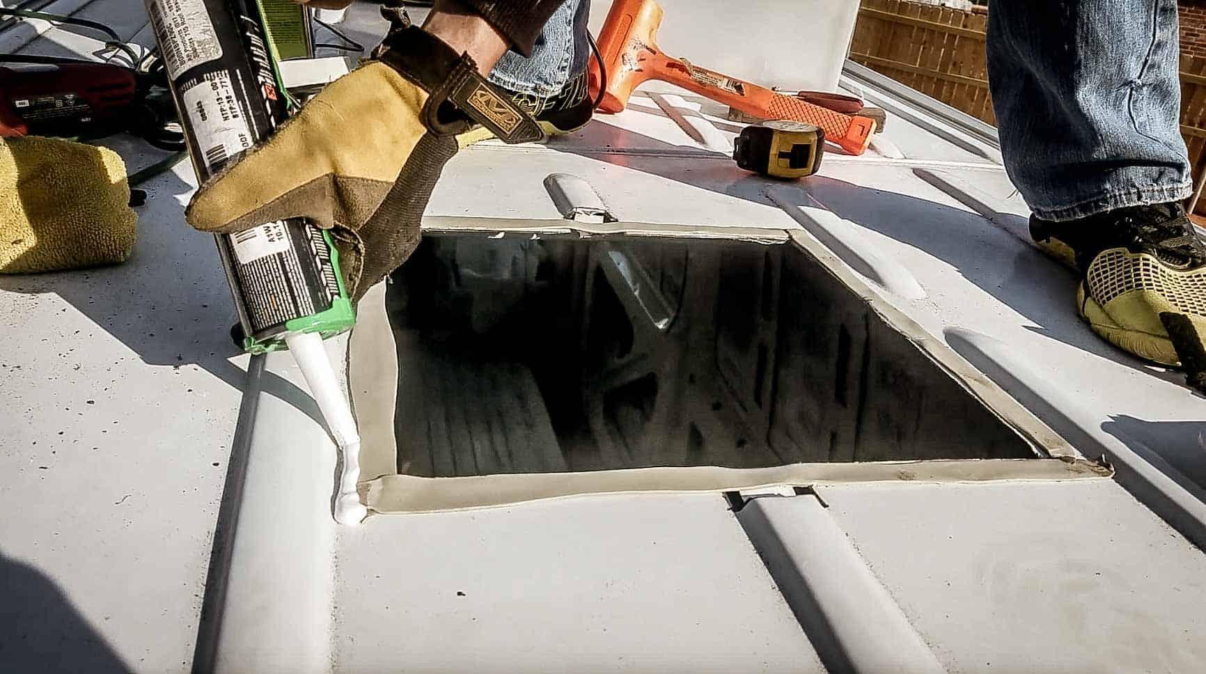 Installing roof vent on campervan-13