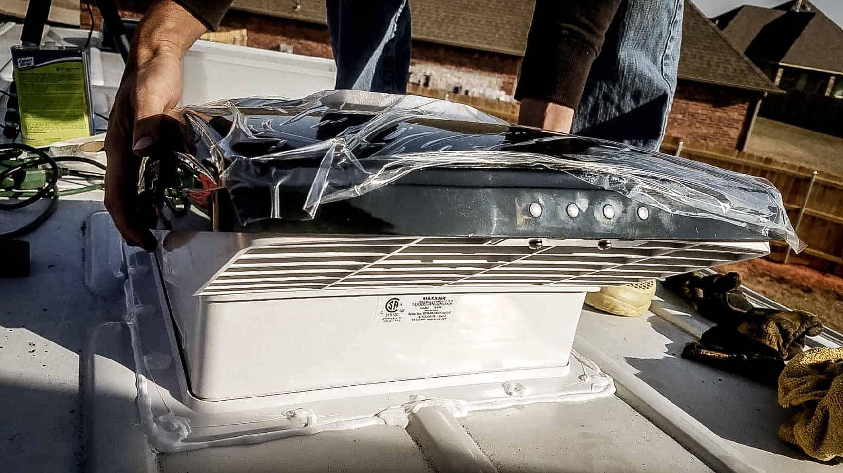 Installing roof vent on campervan-18